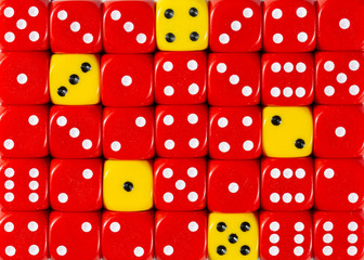Background of random ordered red dices with five yellow cubes
