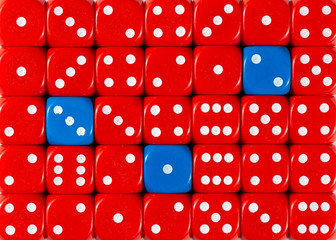 Background of random ordered red dices with three blue cubes