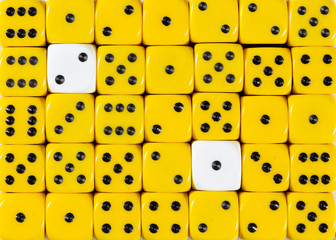 Background of random ordered yellow dices with two white cubes