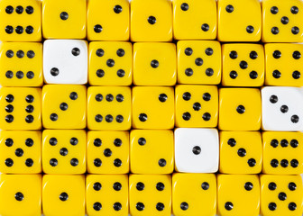 Background of random ordered yellow dices with three white cubes
