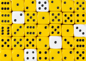 Background of random ordered yellow dices with five white cubes