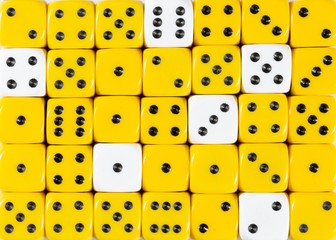 Background of random ordered yellow dices with six white cubes