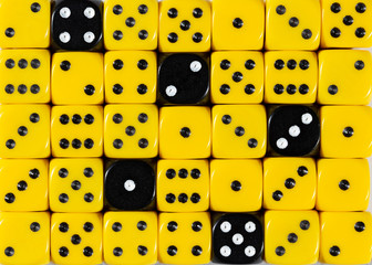 Background of random ordered yellow dices with five black cubes