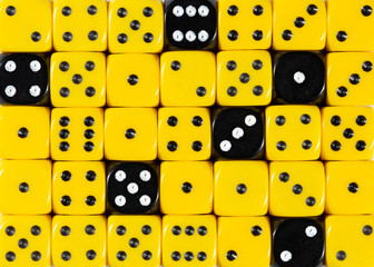 Background of random ordered yellow dices with six black cubes