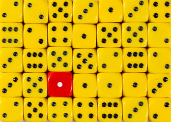 Background of random ordered yellow dices with one red cube