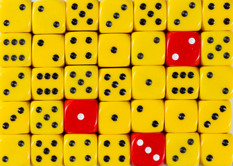 Background of random ordered yellow dices with three red cubes