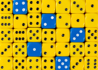 Background of random ordered yellow dices with five blue cubes