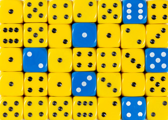 Background of random ordered yellow dices with six blue cubes
