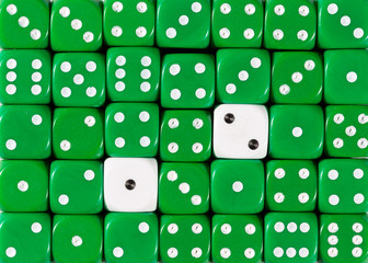 Background of random ordered green dices with two white cubes