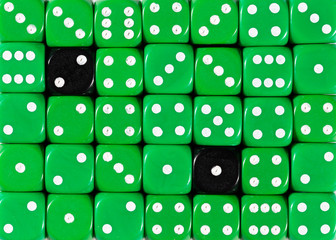 Background of random ordered green dices with two black cubes