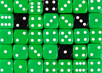 Background of random ordered green dices with four black cubes