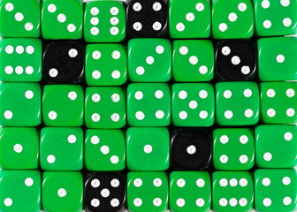 Background of random ordered green dices with five black cubes