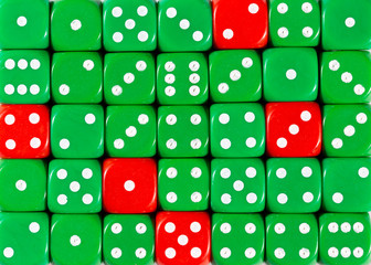 Background of random ordered green dices with five red cubes