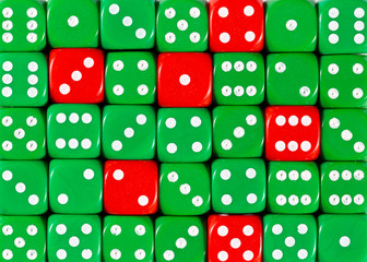 Background of random ordered green dices with six red cubes