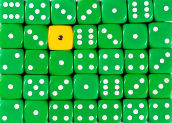 Background of random ordered green dices with one yellow cube