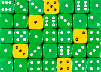 Background of random ordered green dices with five yellow cubes