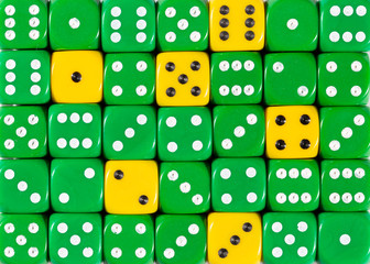 Background of random ordered green dices with six yellow cubes