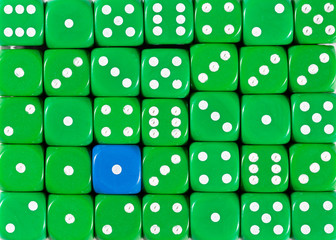 Background of random ordered green dices with one blue cube