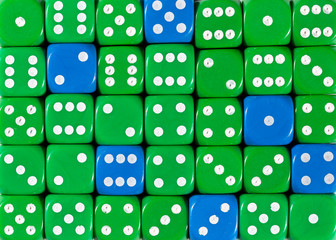Background of random ordered green dices with six blue cubes