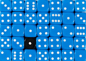 Background of random ordered blue dices with one black cube
