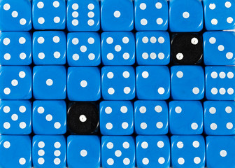 Background of random ordered blue dices with two black cubes