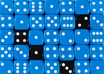 Background of random ordered blue dices with four black cubes