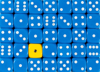 Background of random ordered blue dices with one yellow cube