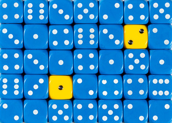 Background of random ordered blue dices with two yellow cubes