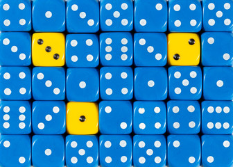 Background of random ordered blue dices with three yellow cubes
