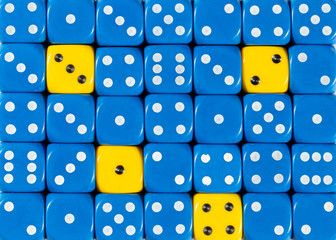Background of random ordered blue dices with four yellow cubes