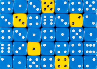 Background of random ordered blue dices with five yellow cubes