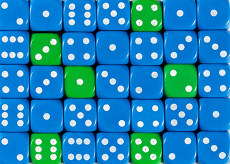 Background of random ordered blue dices with six green cubes