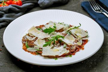 Beef carpaccio with Parmesan and arugula