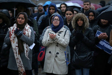 Muslims pray during a vigil for victims of the mosque shootings in New Zealand, outside city hall in Toronto
