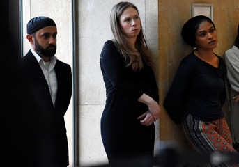 Chelsea Clinton watches with Imam Khalid Latif during a vigil held at NYU Kimmel Center to mourn for the victims of the Christchurch mosque attack in New Zealand
