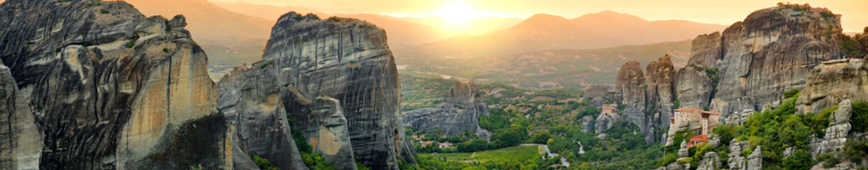 Panoramic view of Meteora valley, a rock formation in central Greece hosting one of the largest complexes of Eastern Orthodox monasteries, built on immense natural pillars.