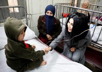 Afghan singer Aryana Sayeed visits a hospital in Kabul
