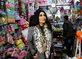 Afghan singer Aryana Sayeed is seen buying toys for children ahead of her visit at the hospital in Kabul