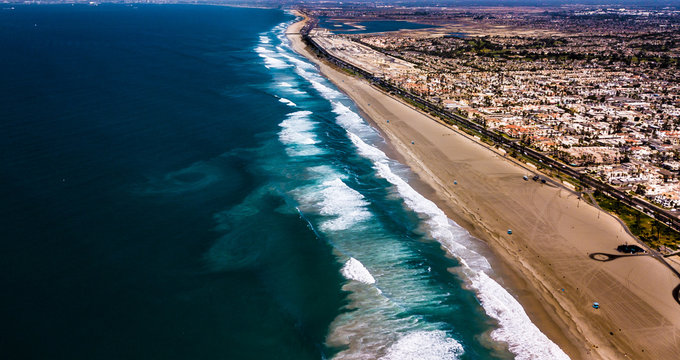 4K Drone Aerial Of Huntington Beaches Looking Down On Pacific Ocean