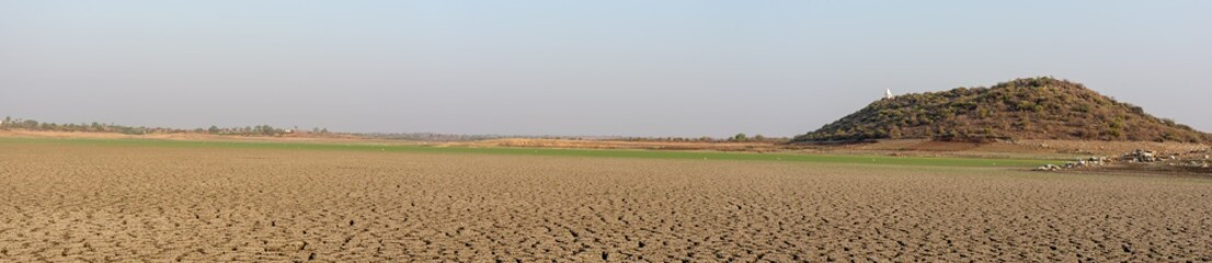 Panorama of a dried up empty reservoir during a summer heatwave in north karnataka,India
