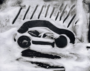 The passenger car is painted on white soap suds. Black background. Car wash concept.