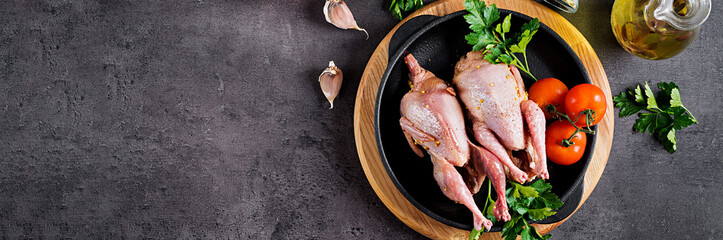 Raw uncooked quail. Ingredients for cooking healthy meat dinner. Banner. Top view