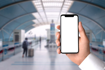 Close up smartphone blank screen, conceptual travel business man commuter train station, copy space
