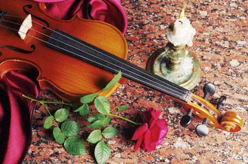 Candle, violin, red rose, drapery