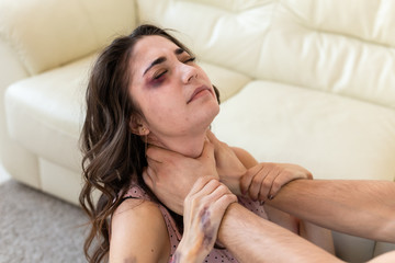Victim, abuse and domestic violence - Woman being abused and strangled by strong man