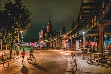 Street scene at night in Berlin, Kreuzberg at Oberbaumbrücke (Oberbaum Bridge).