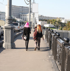 girl and boy  on bridge with creative hairstyle