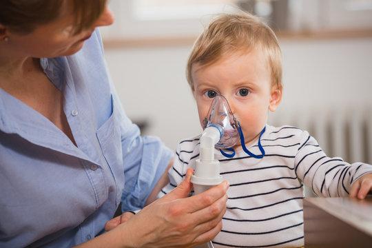little boy inhaling with nebuliser