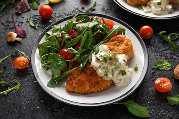 Chicken steak in Breadcrumbs with mushrooms and vegetables