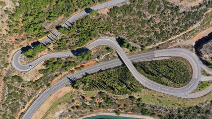 Aerial drone top view photo of snake curvy road built in steep mountain slope